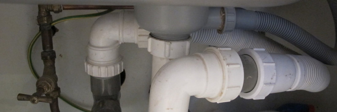 Arco central heating engineers and plumbers in Harold Wood. photo of the pipework under a kitchen sink